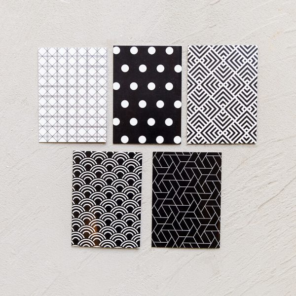 Black and white notecards with polka dots and geometric patterns
