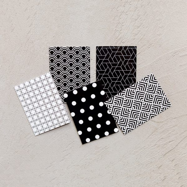 Five different designs of black and white notecards