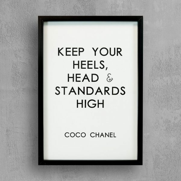 Inspirational quote by Coco Chanel with black frame