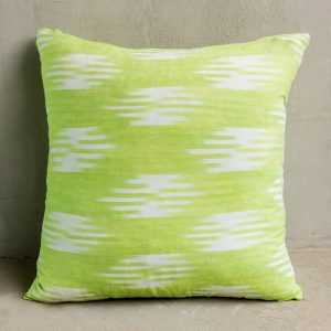 Green and white patterned cushion