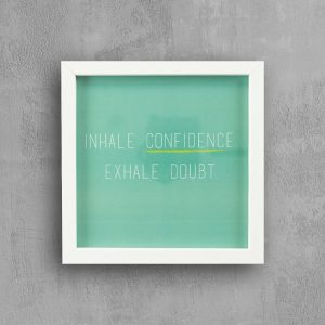 """ Inspirational quote with white frame: Inhale Confidence """