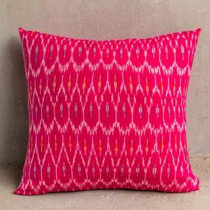 Pink ikat cushion