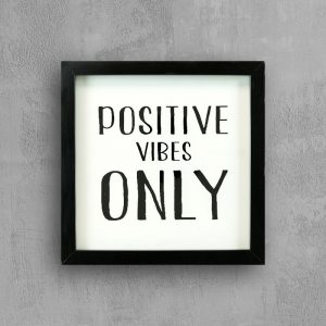 Inspirational quote with black frame: Positive Vibes Only