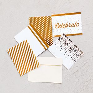 Set of 5 gold and white festive notecards and cream envelope