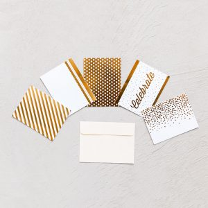5 different pattern of gold and white festive notecards with cream envelope