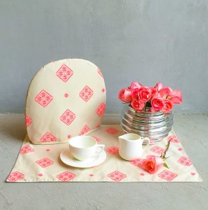 Pop of pink trolley set with tea set and chrome vase