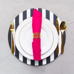 Rani pink napkin with geometric napkin ring and black and white charger