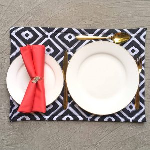 Bling bling napkin ring with coral napkin and black and white place mat