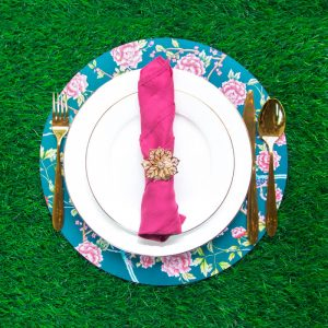 Gold floral napkin ring with rani pink napkin and teal chinoiserie charger