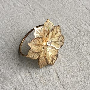 Gold floral napkin ring close up