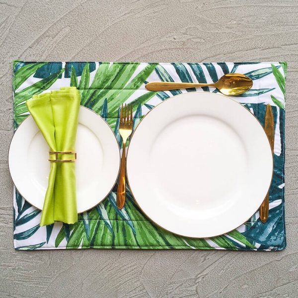 Sparse gold geometric napkin ring with lime green napkin and jungle placemat