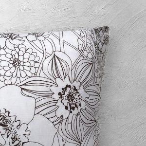 Floral black and white cushion close up