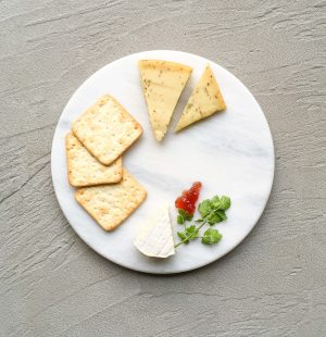 Basic white marble platter with crackers and cheese