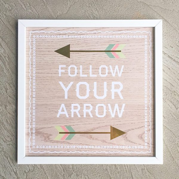"""Follow Your Arrow wall art with white frame """