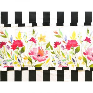 Colorful floral runner with black and white tablecloth