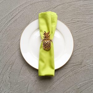 Lime green napkin with gold pineapple napkin ring