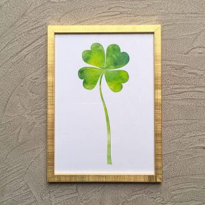 Green clover wall art with gold frame