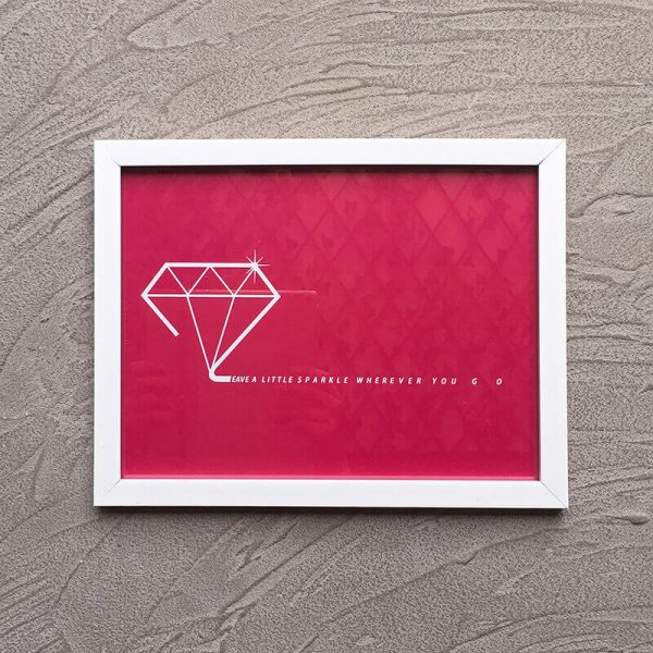 Inspirational quote with white frame: Leave a little sparkle