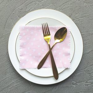 Pink and White Polka Dots Napkins, White plates and Golden cutlery
