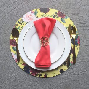 Yellow Floral Charger with white plates, gold cutlery, Coral Napkin and Gold Floral Rose Napkin Ring