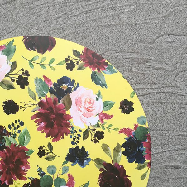 Close-up of Yellow Floral Charger with grey background