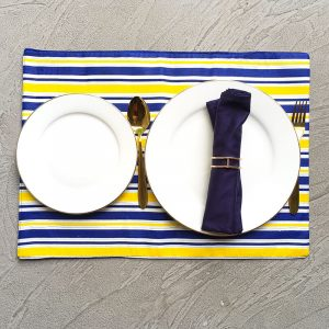 Blue and Yellow Stripes Placemats with white plates, gold cutlery, navy napkin and sparse gold geometric napkin ring.