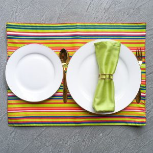 Multi-color Stripes Placemats with white plates, gold cutlery, lime green napkin and sparse gold geometric napkin ring.
