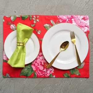 Rose Placemats with white plates, gold cutlery, lime green napkin and sparse gold geometric napkin ring.