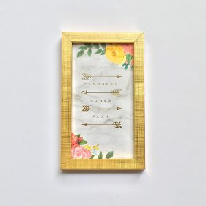 Quote frame of planners gonna plan with grey background and florals with gold frame