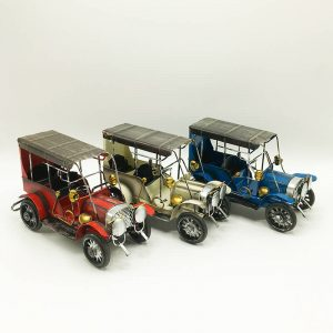 Set of three vintage cars: red, blue and white