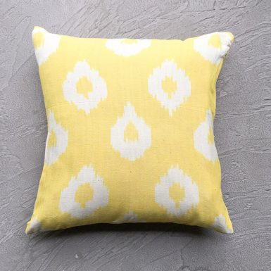 Aerial shot of Lemon Yellow Ikat Cushion